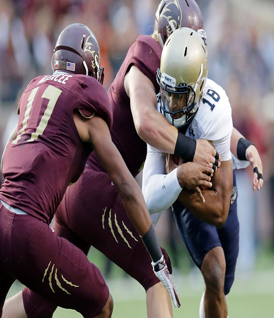 Smith leads Navy past Texas State 35-21 in first career start