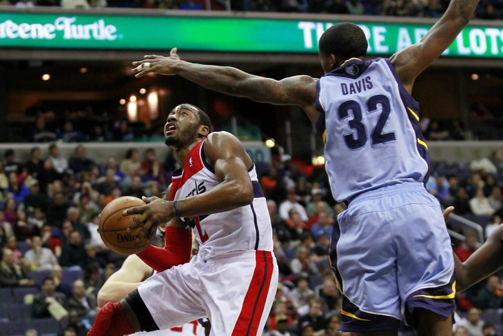 wizards john wall drives against the grizzlies