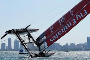 Sailing -Americas Cup World Series - Chicago, Illinois - 10/6/16 - A crew member of Emirates Team New Zealand climbs up the boat as they try to turn the boat upright after capsizing it during a practice session for the America's Cup World Series sailing event. Pointed Magazine Photo © Benjamin Rogers, Jr