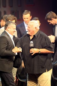 NASCAR Sprint Cup Driver Tony Stewart and Legendary Driver and Owner AJ Foyt meet on stage as Tony's retirement surprise.
